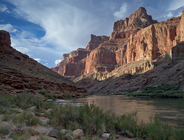 Late afternoon sun illuminates unnamed cliffs near the Above LCR camp at river mile 62, near the confluence of the Colorado and Little Colorado River in the Grand Canyon National Park, Arizona, USA