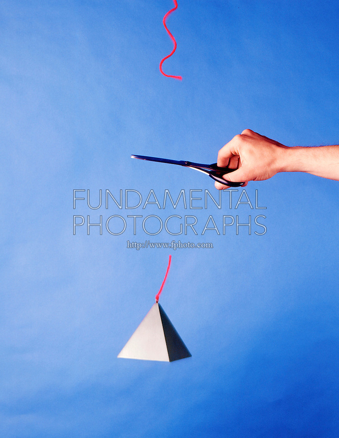 NEWTON'S LAWS OF MOTION<br /> Newton's Second Law: Mass is cut free<br /> (2 of 2)<br /> When the string is cut, one  force is removed ;  the resulting net force from gravity causes the mass to accelerate towards Earth.  A net force on an object causes it to accelerate in direct proportion to the force & in inverse proportion to its mass.