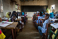 Senegal, Touba.  Students at Al-Azhar Madrasa, a School for Islamic Studies.  Their books show that they are studying Arabic.