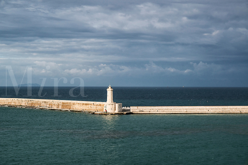 Breakwater and lighthouse protecting the harbor of Civitavecchia, Lazio, Italy