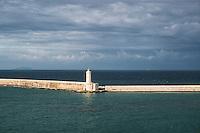 Breakwater and lighthouse protecting the harbor of Civitavecchia, Lazio, Italy