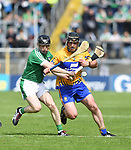 Graeme Mulcahy of Limerick in action against Gearóid O'Connell of Clare during their Munster Championship semi-final at Thurles.  Photograph by John Kelly.