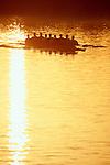 Rowing, men's eight oared racing shell in sunrise silhouette, Seattle,