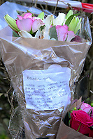 """Pictured: Flowers left at the house where the body of Terri-Anne Jones was discovered in Cimla, Neath, Wales.<br /> Re: John Paul Lewis who stabbed his girlfriend Terrie-Ann Jones 26 times and then went to the pub has been jailed for life for her murder.<br /> 55 year old Lewis, left the mother of two, 33 year old Terrie-Ann Jones, in a pool of blood after the attack in her home in Cimla, south Wales, on 5 January 2018.<br /> He then took money from her purse, changed his clothes and went to the pub, Swansea Crown Court was told.<br /> Lewis, who initially claimed he was acting in self-defence, must serve a minimum of 19 years.<br /> He had pleaded not guilty to murder but was convicted by a jury.<br /> Ms Jones's family said in a statement after the verdict : """"Everyone that knew her loved her and we cannot tell you how much we are missing her.<br /> """"Her passing has forever changed the lives of her daughter and little boy, who at nine years old doesn't understand why his mummy isn't here to play with him any more."""""""