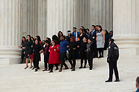 People link arms as they depart the Supreme Court after hearing arguments on the Deferred Action for Childhood Arrivals program in Washington D.C., U.S. on Tuesday, November 12, 2019.<br /> <br /> Credit: Stefani Reynolds / CNP /MediaPunch