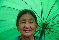 Old women and her umbrella Banaue Mountain Province Rice Terraces Philippines