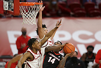Arkansas guard JD Notae (1) and forward Jaylin Williams (10) blocks Georgia Tye Fagan (14), Saturday, January 9, 2021 during the second half of a basketball game at Bud Walton Arena in Fayetteville. Check out nwaonline.com/210110Daily/ for today's photo gallery. <br /> (NWA Democrat-Gazette/Charlie Kaijo)