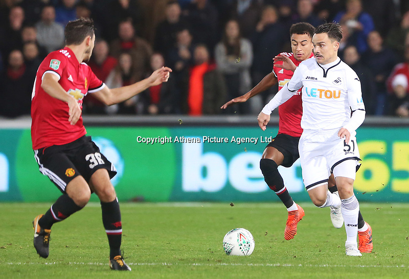 Roque Mesa of Swansea City is marked by Matteo Darmian of Manchester United during the Carabao Cup Fourth Round match between Swansea City and Manchester United at the Liberty Stadium, Swansea, Wales, UK. Tuesday 24 October 2017