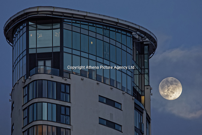 Pictured: The moon rises over the Meridian Quay in Swansea Marina, Wales, UK. Monday 18 February 2019<br /> Re: February's full moon will be the biggest supermoon of 2019.<br /> The supermoon occurs during this full moon because it will be closest to Earth. The supermoon will reach its peak on Tuesday morning but won't be visible.