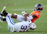 CHARLOTTESVILLE, VA- NOVEMBER 12: Wide receiver Tim Smith #20 of the Virginia Cavaliers is tackled by cornerback Johnny Williams #37 of the Duke Blue Devils during the game on November 12, 2011 at Scott Stadium in Charlottesville, Virginia. Virginia defeated Duke 31-21. (Photo by Andrew Shurtleff/Getty Images) *** Local Caption *** Johnny Williams;Tim Smith