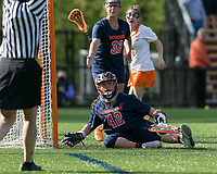 Newton, Massachusetts - May 11, 2018: NCAA Division I. In overtime, Princeton University (white) defeated Syracuse University (blue), 12-11, at Newton Campus Lacrosse Field.<br /> Hannah Van Middelem disputes whether ball completely crossed into goal.
