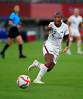 TOKYO, JAPAN - JULY 20: Crystal Dunn #2 of the United States chases down a loose ball during a game between Sweden and USWNT at Tokyo Stadium on July 20, 2021 in Tokyo, Japan.