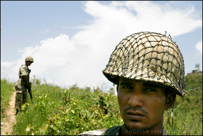 Royal Nepal Army soldiers guard a communications tower in Dang district, West Nepal on 12 June, 2004.<br />