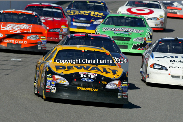 3/7/04,LAS VEGAS,NEVADA --- Matt Kenseth #17 Dewalt Power Tools Ford leads the pack en route to winning the UAW-Daimler Chrysler 400 at the Las Vegas Motor Speedway for the second consecutive year. --- Chris Farina