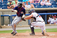 Michael Taylor #3 of the Hagerstown Suns tries to score a run as Jace Whitmer #39 of the Rome Braves applies a tag without the baseball at State Mutual Stadium on May 1, 2011 in Rome, Georgia.   Photo by Brian Westerholt / Four Seam Images