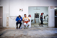 Seat in a corner of the training room, Khalifa is an attentive observer. He comments with his friend Omar Chaima on the technique of the young  boxers.