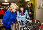 TORRINGTON, CT. 20 December 2019-122019BS14 - From left, Christmas angels Donna Finnerman, Sondra and Kevin Zak look over the shoes and boots they brought to give to everyone at the shelter, during a visit by Santa at the FISH of Northwestern Connecticut Homeless Shelter in Torrington on Friday. Bill Shettle Republican-American