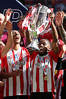 Tariqe Fosu holds the Championship Trophy aloft as Brentford celebrate promotion to the Premier League during Brentford vs Swansea City, Sky Bet EFL Championship Play-Off Final Football at Wembley Stadium on 29th May 2021