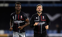 Lincoln City's assistant manager Nicky Cowley, right, joins in the post match fitness session alongside Lincoln City's Jordan Adebayo-Smith<br /> <br /> Photographer Chris Vaughan/CameraSport<br /> <br /> The Carabao Cup First Round - Huddersfield Town v Lincoln City - Tuesday 13th August 2019 - John Smith's Stadium - Huddersfield<br />  <br /> World Copyright © 2019 CameraSport. All rights reserved. 43 Linden Ave. Countesthorpe. Leicester. England. LE8 5PG - Tel: +44 (0) 116 277 4147 - admin@camerasport.com - www.camerasport.com