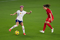 ORLANDO CITY, FL - FEBRUARY 18: Megan Rapinoe #15 cuts the ball while pressured during a game between Canada and USWNT at Exploria stadium on February 18, 2021 in Orlando City, Florida.
