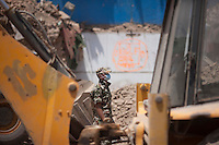Nepali rescue workers using excavators to clear rubble at Kathmandu Durbar Square, Nepal.  May 03, 2015