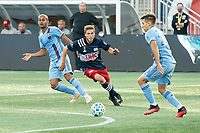 FOXBOROUGH, MA - SEPTEMBER 19: Scott Caldwell #6 of New England Revolution tries to chase down the ball as Nicolas Acevedo #26 of New York City FC prepares to push forward during a game between New York City FC and New England Revolution at Gillette on September 19, 2020 in Foxborough, Massachusetts.