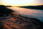 Sunrise over Lake of the Clouds, Porcupine Mountain Wilderness State Park, Ontonagon county, Upper Peninsula of Michigan. An early morning fog bank covers the lake explaining the origin of its name.