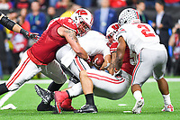 Indianapolis, IN - DEC 7, 2019: Wisconsin Badgers linebacker Zack Baun (56) and Wisconsin Badgers defensive end Isaiahh Loudermilk (97) sack Ohio State Buckeyes quarterback Justin Fields (1) during Big Ten Championship game between Wisconsin and Ohio State at Lucas Oil Stadium in Indianapolis, IN. Ohio State came back from a 21-7 deficit at halftime to beat Wisconsin 34-21 to win its third straight Big Ten Championship. (Photo by Phillip Peters/Media Images International)