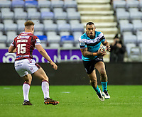 29th April 2021; DW Stadium, Wigan, Lancashire, England; BetFred Super League Rugby, Wigan Warriors versus Hull FC;  Mahe Fonua of Hull FC runs into contact with Smithies of Wigan