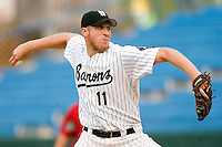 Birmingham Barons starting pitcher Adam Russell winds up to deliver the ball to the plate versus the Chattanooga Lookouts at Hoover Metropolitan Stadium in Birmingham, AL, Sunday, August 20, 2006.