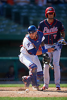 South Bend Cubs catcher Tyler Alamo (22) retrieves the ball after blocking a pitch in the dirt as Carlos Torres (7) bats during the second game of a doubleheader against the Peoria Chiefs on July 25, 2016 at Four Winds Field in South Bend, Indiana.  South Bend defeated Peoria 9-2.  (Mike Janes/Four Seam Images)