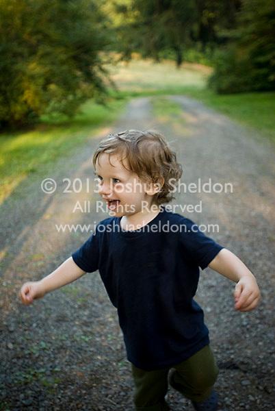 Baby boy walking, laughing