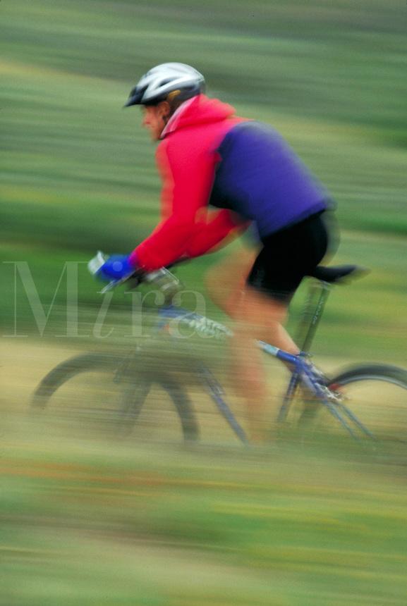 Woman mountain biking, blurred motion, Rocky Mountains, Colorado. Colorado.