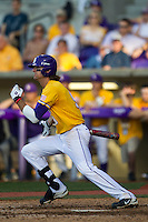 LSU Tigers outfielder Mark Laird (9) follows through on his swing during the Southeastern Conference baseball game against the Texas A&M Aggies on April 25, 2015 at Alex Box Stadium in Baton Rouge, Louisiana. Texas A&M defeated LSU 6-2. (Andrew Woolley/Four Seam Images)