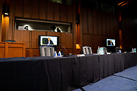Empty chais of Senate Democrats are seen during the Senate Judiciary Committee business meeting on the fourth day of the confirmation hearing for Judge Amy Coney Barrett, President Donald Trump's Nominee for Supreme Court, in Hart Senate Office Building in Washington DC, on October 15th, 2020.<br /> Credit: Anna Moneymaker / Pool via CNP /MdeiaPunch