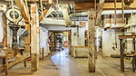 Vintage flour milling equipment inside Thompson's Mills State Heritage Site, Oregon State Parks.  Vintage, preserved, agricultureal milling equipment and site.