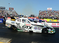 Sept. 22, 2012; Ennis, TX, USA: NHRA funny car driver Mike Neff (near lane) races alongside Johnny Gray in first round of the Traxxas Funny Car Shootout during qualifying for the Fall Nationals at the Texas Motorplex. Mandatory Credit: Mark J. Rebilas-