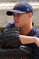 Pitcher Asher Demme of the Danville Braves, Appalachian League affiliate of the Atlanta Braves, watches a game against the Princeton Devil Rays on August 18, 2005, at Dan Daniel Park, Danville, Va. (Tom Priddy/Four Seam Images)