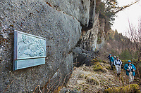 Visitors view plaque that commemorates the Russian exploration expedition that landed on Kayak Island in 1741, Gulf of Alaska, southcentral, Alaska.