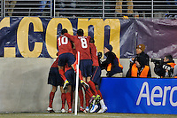 Juan Agudelo (9) of the United States celebrates scoring with teammates. The United States (USA) and Argentina (ARG) played to a 1-1 tie during an international friendly at the New Meadowlands Stadium in East Rutherford, NJ, on March 26, 2011.