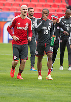 Toronto, Ontario - May 3, 2014: Toronto FC midfielder Michael Bradley #4 talks with Toronto FC forward Jermain Defoe #18 in the warm-up during a game between the New England Revolution and Toronto FC at BMO Field.<br /> The New England Revolution won 2-1.