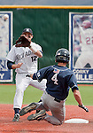 March 30, 2012:   Nevada Wolf Pack shortstop Garrett Yrigoyen takes the throw as  BYU Cougars Jaycob Brugman attempts to steal second during their NCAA baseball game played at Peccole Park on Friday afternoon in Reno, Nevada.