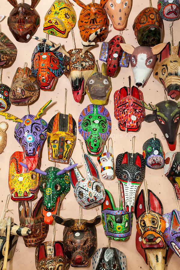 Antigua, Guatemala.  Masks of Mythical Maya Figures.  Nim Po't Handicrafts Outlet.