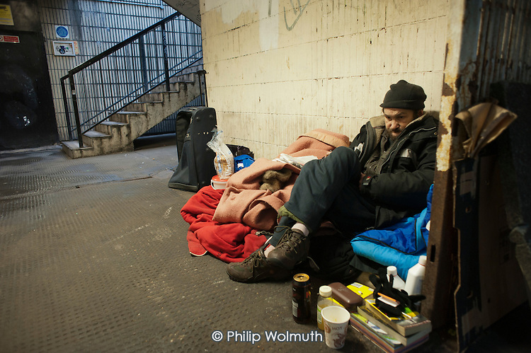 A homeless man living in the subway beneath at Old Street roundabout in Shoreditch, London, a run-down commercial district  also known as Silicon Roundabout, which is undergoing gentrification as it becomes a centre for web-based companies and IT start-ups.
