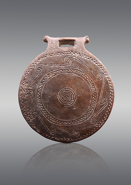 Cucladic Syros style decorated terra cotta frying pan . Early Cycladic Period II, (2800-2300 BC), Museum of Cycladic Art Athens,  cat no 971.  Grey Background.