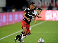 WASHINGTON, DC - MAY 13: Andy Najar #14 of D.C. United battles for the ball with Przemyslaw Frankowski #11 of Chicago Fire during a game between Chicago Fire FC and D.C. United at Audi FIeld on May 13, 2021 in Washington, DC.