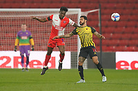 Anthony Stewart of Wycombe Wanderers and Andre Gray of Watford during the Sky Bet Championship behind closed doors match between Watford and Wycombe Wanderers at Vicarage Road, Watford, England on 3 March 2021. Photo by David Horn.