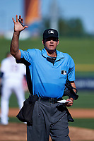 Home plate umpire Ryan Additon motions to the scoring booth between innings of an Arizona Fall League game between the Mesa Solar Sox and the Glendale Desert Dogs on October 28, 2017 at Sloan Park in Mesa, Arizona. The Solar Sox defeated the Desert Dogs 9-6. (Zachary Lucy/Four Seam Images)
