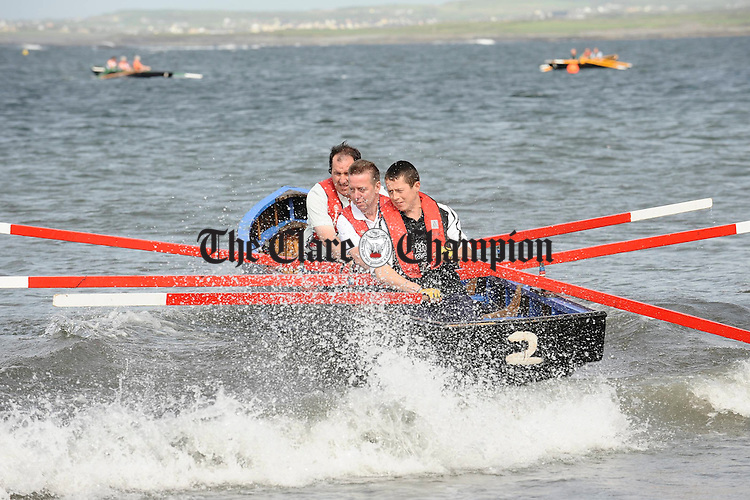 Michael Kelleher, Austin Boyle and Micheal O Doherty launch for Quilty at the Leon Currach Regatta at Seafield, Quilty. Photograph by John Kelly.