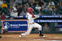 Cole Austin (16) of the Arkansas Razorbacks follows through on his swing against the Baylor Bears in game nine of the 2020 Shriners Hospitals for Children College Classic at Minute Maid Park on March 1, 2020 in Houston, Texas. The Bears defeated the Razorbacks 3-2. (Brian Westerholt/Four Seam Images)